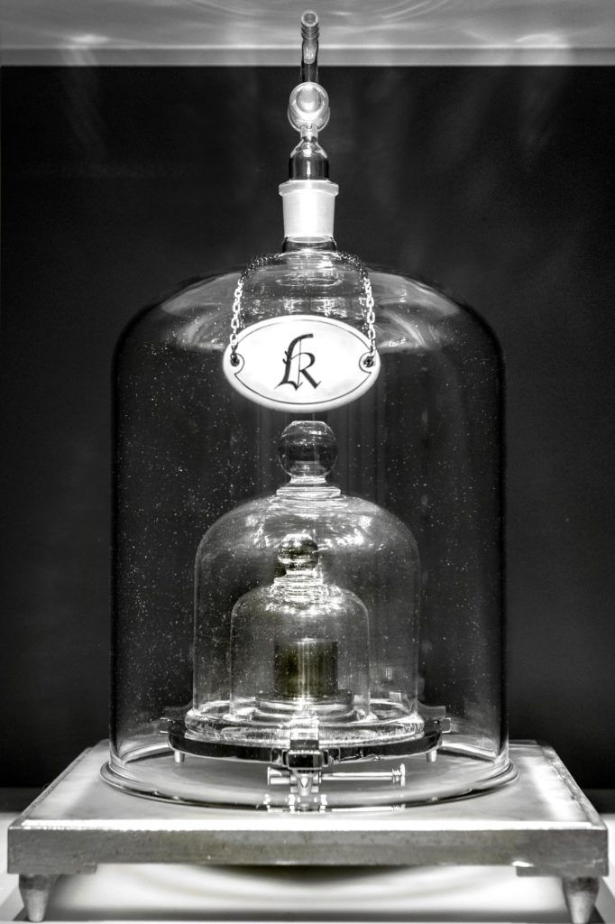 The International Prototype of the Kilogram, also known as Le Grand K, was the internationally sanctioned artifact that defined the amount of weight equivalent to one kilogram. It is kept under three glass domes in a vault for protection. Image courtesy of BIPM.