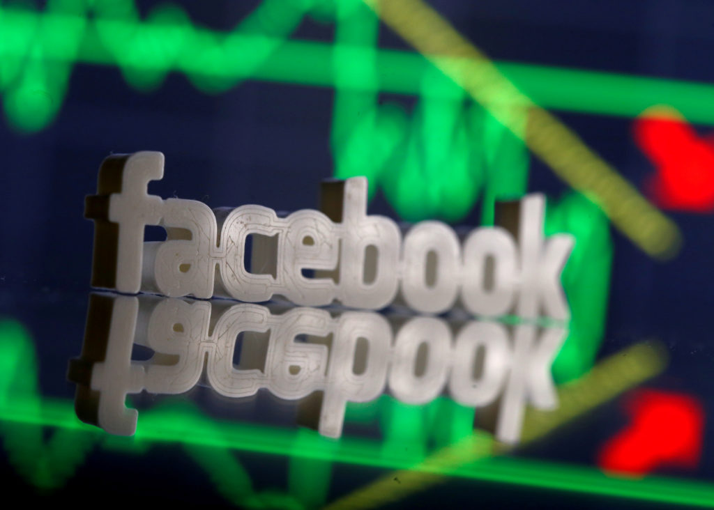 A 3D-printed Facebook logo is seen in front of displayed stock graph in this illustration photo, March 20, 2018. REUTERS/D...