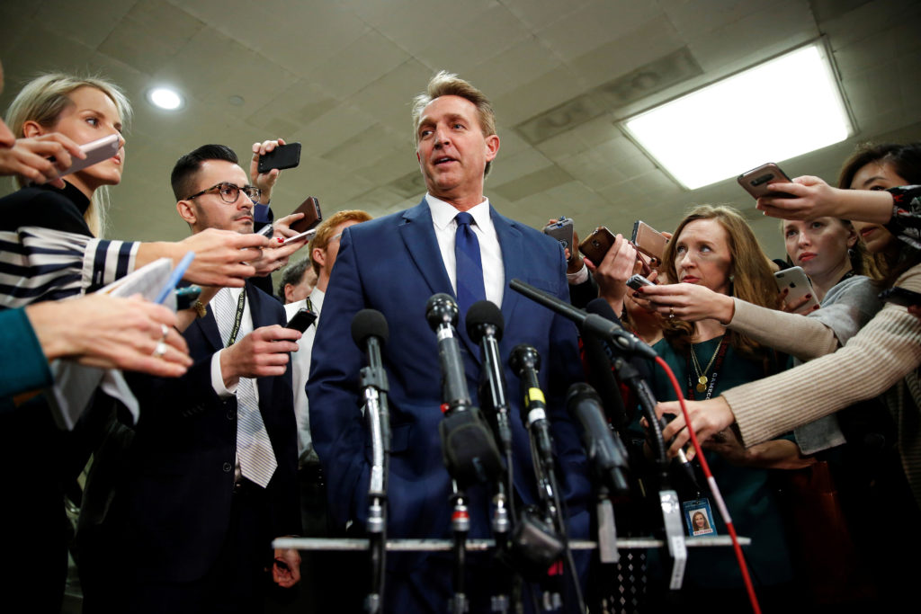 Senator Jeff Flake (R-Ariz.) speaks to the media after a closed briefing for senators about the latest developments related to the death of Saudi journalist Jamal Khashoggi on Capitol Hill in Washington, D.C. Photo by Joshua Roberts/Reuters