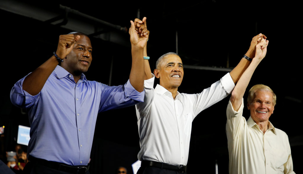 Former U.S. President Barack Obama (C) campaigns for Democrats, U.S. Senator Bill Nelson (R) and and Gubernatorial candidate Andrew Gillum (L) in Miami, Florida, U.S. November 2, 2018. REUTERS/Joe Skipper