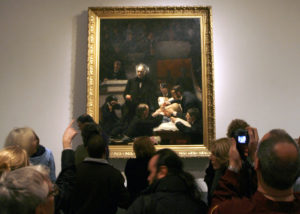 Viewers crowd around 'The Gross Clinic' painting during the 2007 public opening at the Philadelphia Museum of Art in Philadelphia. Photo by Tim Shaffer/Reuters