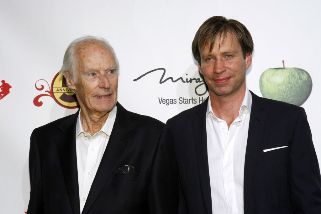 File photo of music producers George Martin (left) and his son Giles Martin by Steve Marcus/Reuters