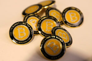 Bitcoin.com buttons are seen displayed on the floor of the Consensu…