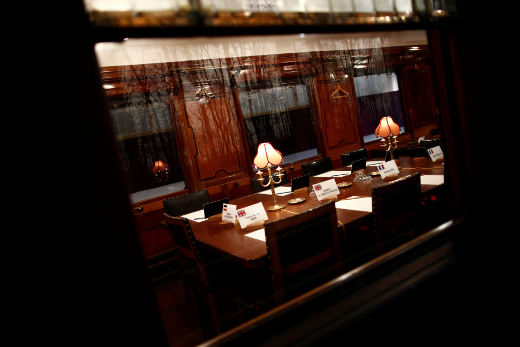 A view shows the table inside the replica of the wagon where the Germans signed the armistice in 1918 that ended the World War One at the Armistice Museum in the Clairiere de Rethondes in Compiegne, France, August 30, 2018.  Picture taken August 30, 2018.   Photo by Christian Hartmann/Reuters