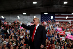 U.S. President Donald Trump waves during a campaign rally at Southport High School in Indianapolis, Indiana. If the economy falters before 2020, it could make his reelection bid more difficult. Photo by Carlos Barria/Reuters