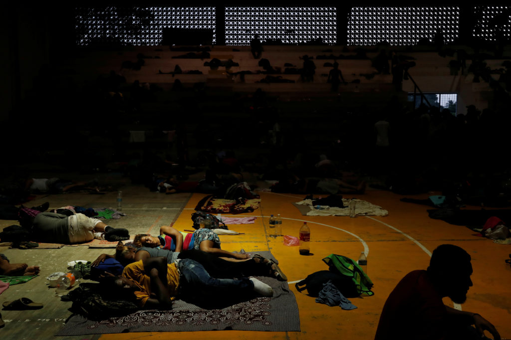 Migrants, part of a caravan traveling to the U.S., rest in a gym after arriving in Mapastepec, Mexico November 2, 2018. Picture taken November 2, 2018. Photo by Leah Millis/Reuters