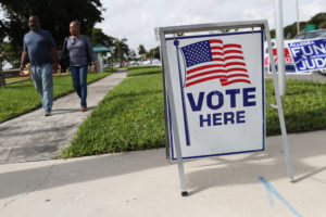 A voting sign is seen outside polling station in Riviera Beach, Florida, U.S., November 4, 2018. Photo by REUTERS/Shannon Stapleton