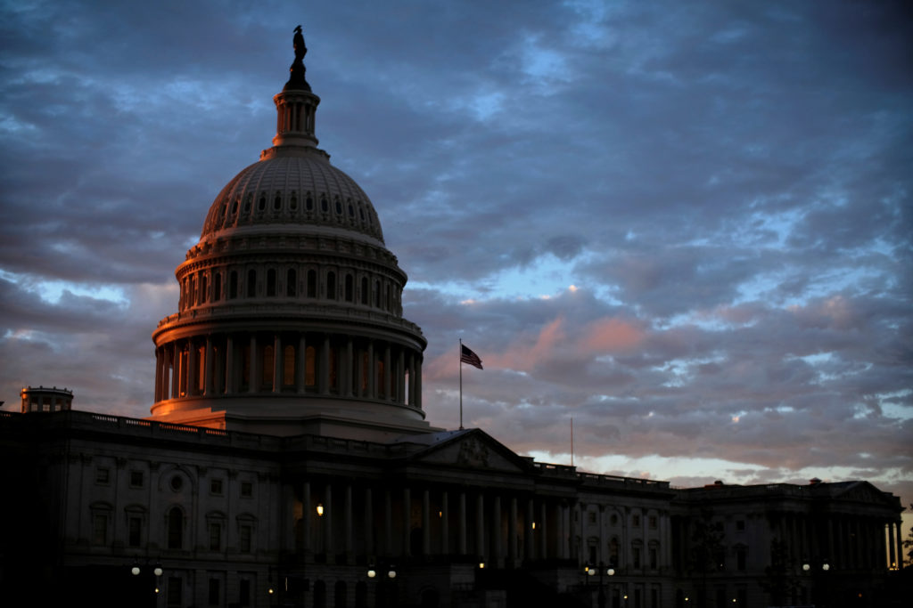 The sun sets behind the U.S. Capitol dome in Washington, U.S., on midterm election day, November 6, 2018. Photo by REUTERS/James Lawler Duggan