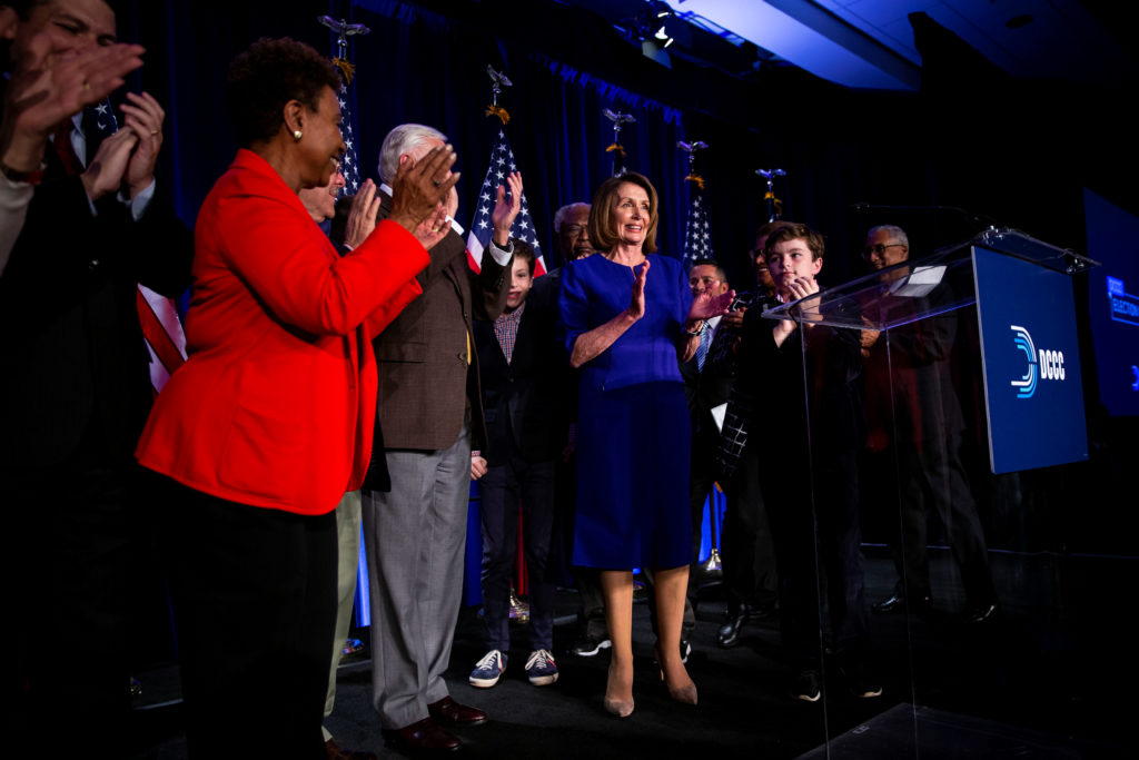 U.S. House Minority Leader Nancy Pelosi reacts alongside fellow House Democrats to the results of the U.S. midterm elections at a Democratic election night rally in Washington. Photo by Al Drago/Reuters