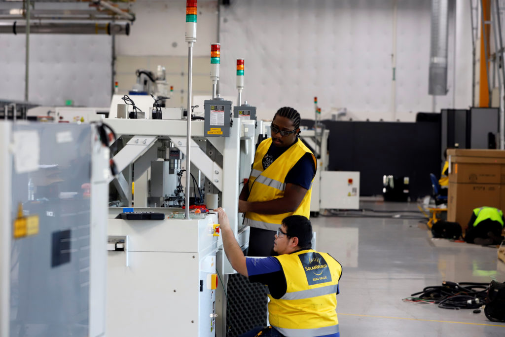 SunPower equipment technicians install P-Series solar panel manufacturing technology at its Hillsboro manufacturing plant in Hillsboro, Oregon. Photo by Steve Dipaola/Reuters