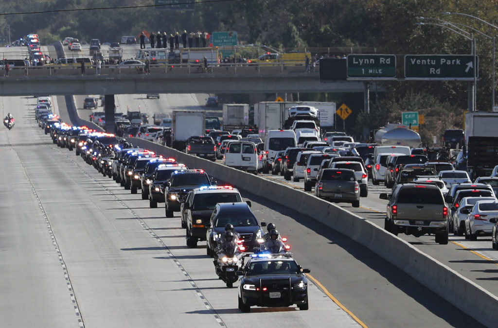 A procession for the body of  Sgt. Ron Helus, who died in the shooting in Thousand Oaks, travels down Ventura Highway 101 on Thursday. Photo by Mike Blake/Reuters