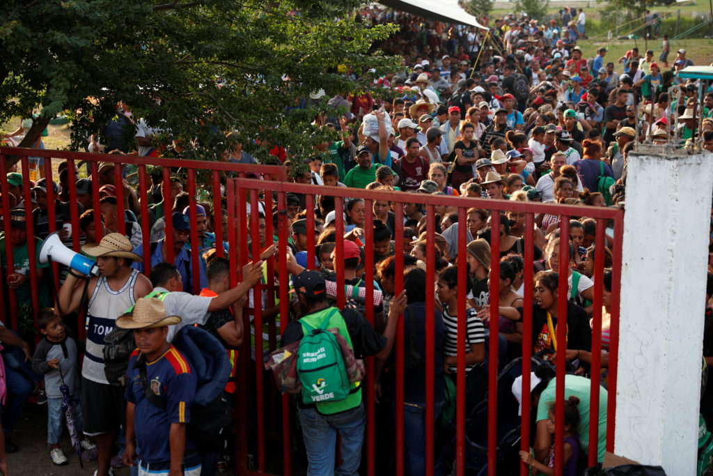 Migrants, part of a caravan traveling en route to the United States, gather as they wait for transportation in Matias Romero Avendano, Mexico November 9, 2018. Photo by Carlos Garcia Rawlins/Reuters