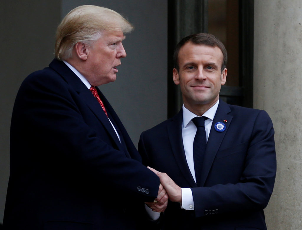 French President Emmanuel Macron shakes hands with U.S. President Donald Trump after a meeting at the Elysee Palace on the...