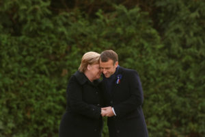 French President Emmanuel Macron and German Chancellor Angela Merkel hold hands after unveiling a plaque in the Clairiere of Rethondes during a commemoration ceremony for Armistice Day, 100 years after the end of the First World War, in Compiegne, France, November 10, 2018. Photo by Philippe Wojazer/Pool via Reuters
