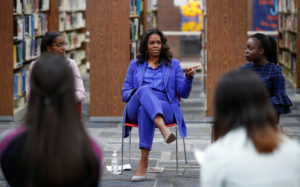 Former first lady Michelle Obama begins her book tour with a stop at the Whitney M. Young Magnet High School in Chicago, Illinois. Photo by Kamil Krzaczynski/Reuters