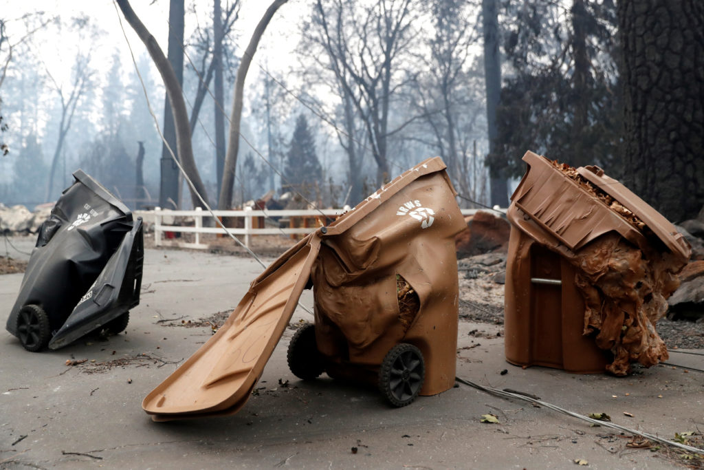 Trash cans destroyed by the Camp Fire are seen in Paradise, California. Photo by Terray Sylvester/Reuters