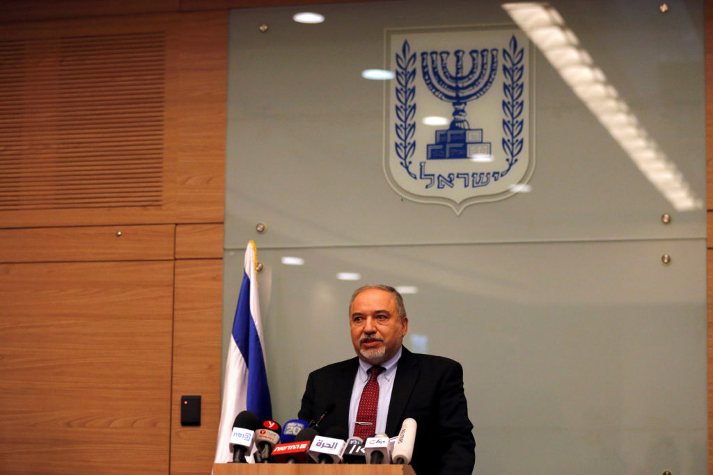 Israel's Defence Minister Avigdor Lieberman delivers a statement to the media following his party, Yisrael Beitenu, factio...