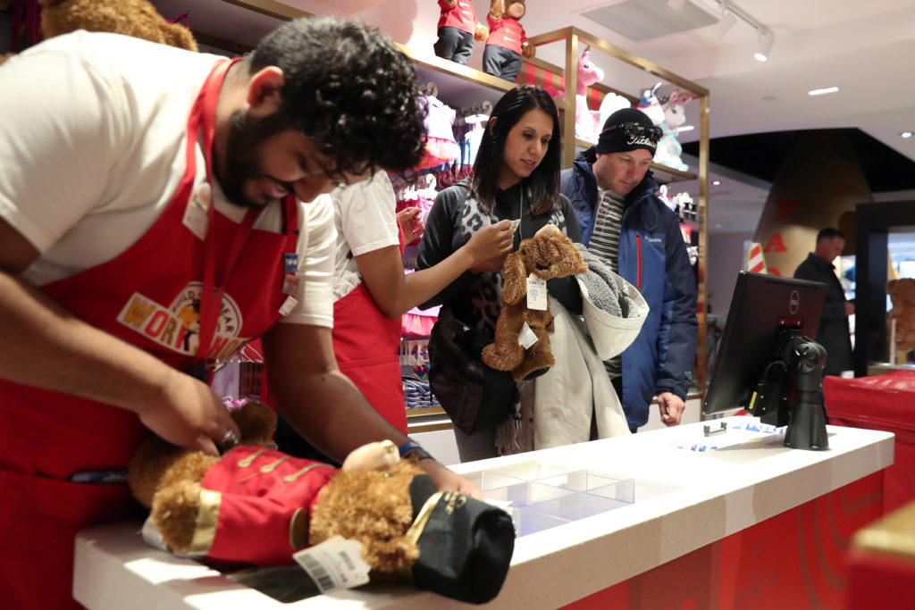 People shop at the new flagship FAO Schwarz store in Rockefeller Plaza in New York. Toys are not on the current list of Chinese goods subject to tariffs, but they could be included in the next round. Photo by Shannon Stapleton/Reuters
