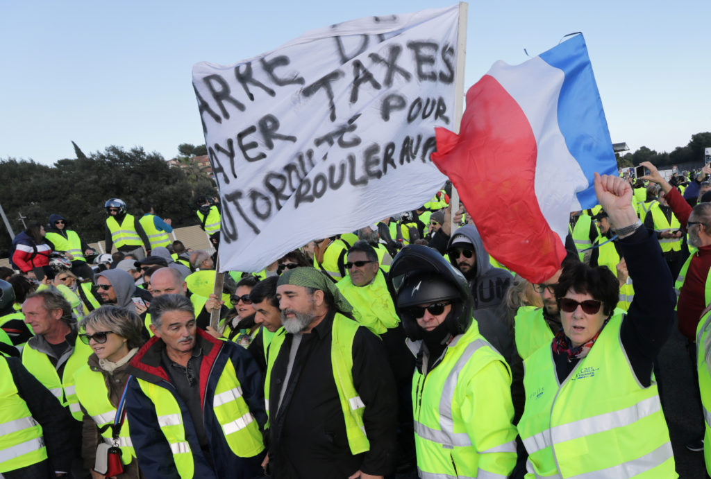 People wearing yellow vests, a symbol of a French drivers' protest against higher fuel prices, block the motorway in Antibes, France, November 17, Photo by Eric Gaillard/Reuters