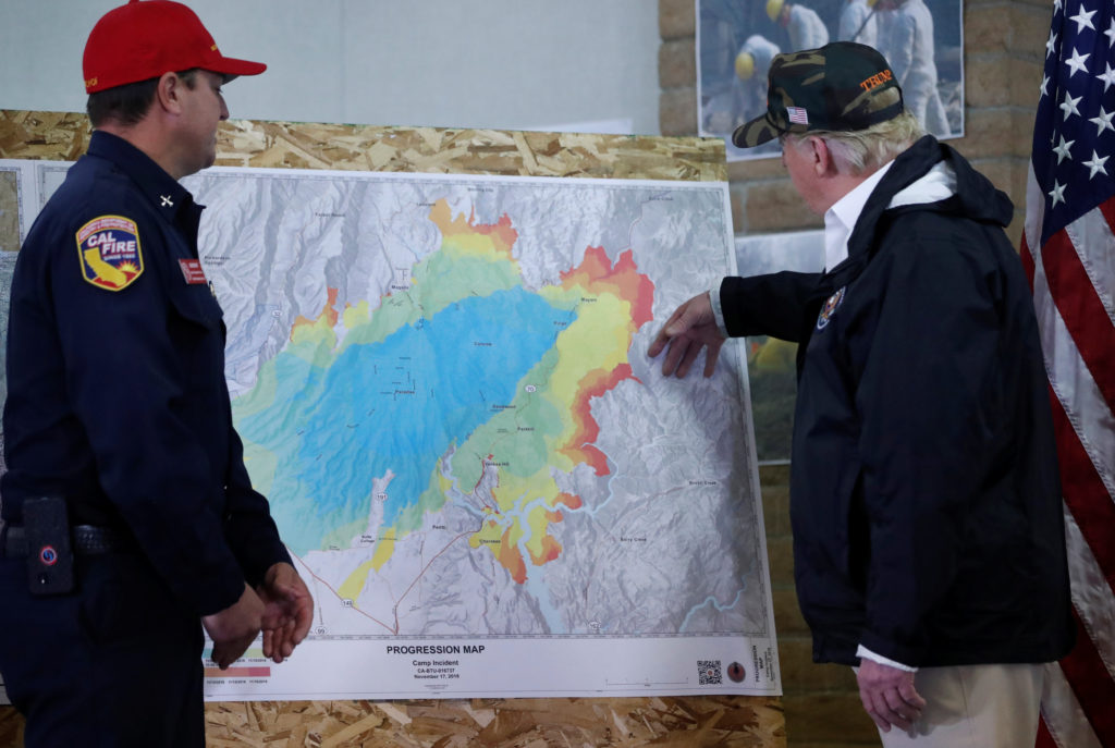 U.S. President Donald Trump asks questions about a fire map to Josh Bischof, Operations Branch Director of Incident Management Team 4 of Cal Fire while visiting an operations center near Paradise in Chico, California, U.S., November 17, 2018. Photo by Leah Millis/Reuters