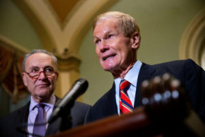Sen. Bill Nelson (D-Fla.) speaks alongside Senate Democratic Leader Chuck Schumer (D-N.Y.) about the Florida U.S. Senate election, in the U.S. Capitol, in Washington, U.S., November 13, 2018. Photo by Al Drago/Reuters