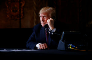 President Donald Trump speaks via video teleconference with troops from Mar-a-Lago estate in Palm Beach, Florida, on Thanksgiving. Photo by Eric Thayer/Reuters