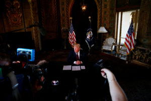 President Donald Trump takes questions from the media after speaking via teleconference with troops from Mar-a-Lago estate in Palm Beach, Florida. Photo by Eric Thayer/Reuters