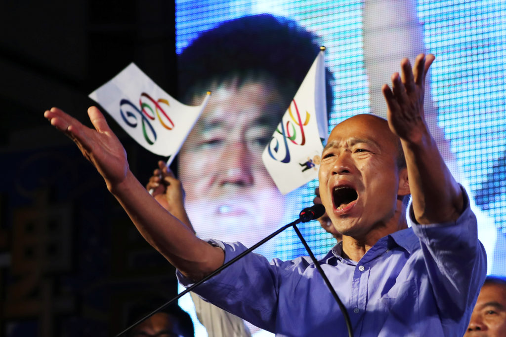 Opposition Nationalist Kuomintang Party (KMT) Kaohsiung mayoral candidate Han Kuo-yu celebrates after winning in local ele...