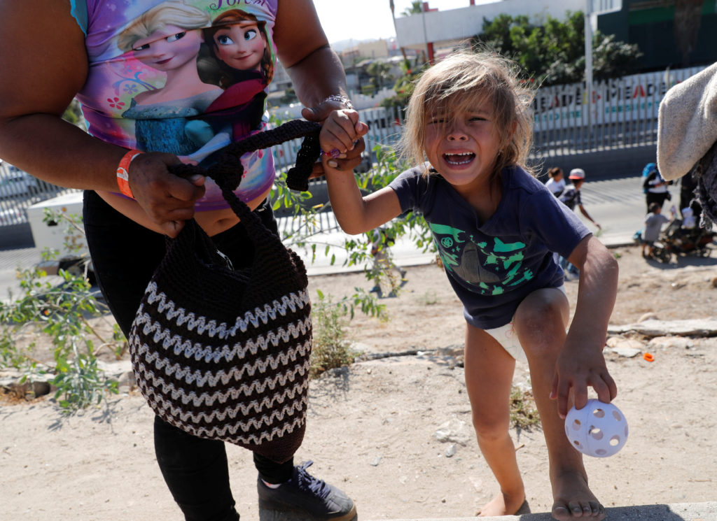 A migrant girl from Honduras, part of a caravan of thousands traveling from Central America en route to the United States,...