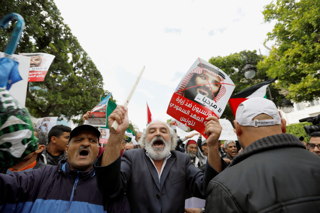 A man reacts as he takes part in a protest opposing the visit of Saudi Arabia's Crown Prince Mohammed bin Salman in Tunis,...