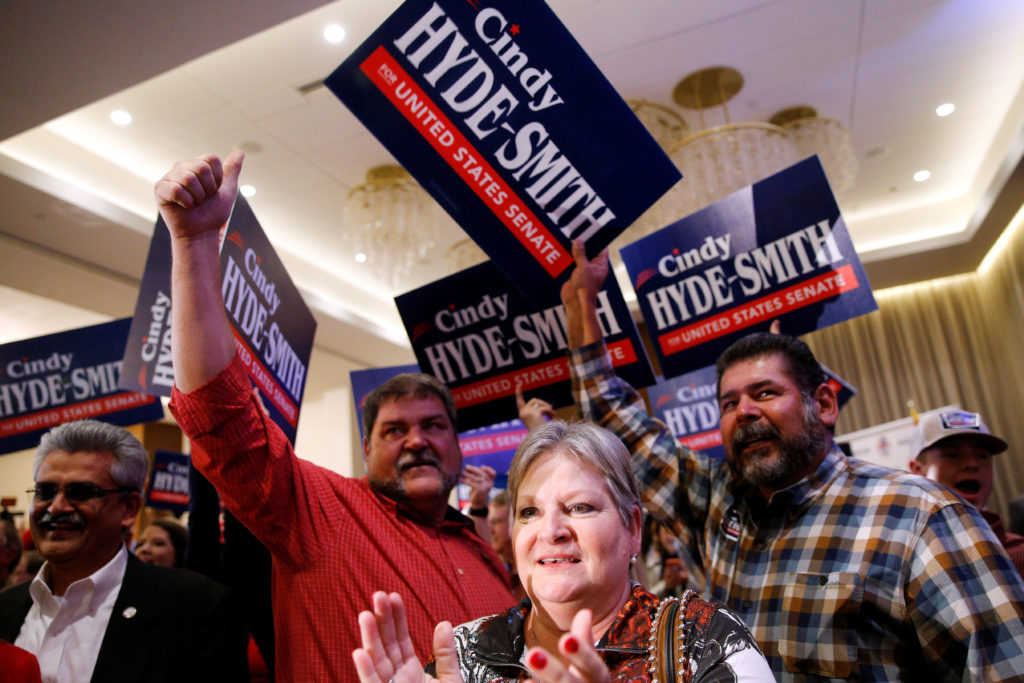 Supporters of Republican Sen. Cindy Hyde Smith celebrate during an election night party in Jackson Mississippi