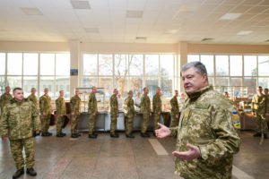 "Ukraine's President Petro Poroshenko (R, front) addresses servicemen as he visits the 169th training centre ""Desna"" of the Ukrainian Army ground forces in Chernihiv Region, Ukraine. Photo by Mykola Lazarenko/Ukrainian Presidential Press Service via Reuters"