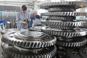 Workers inspect engine gears at a company under Dongbei Special Steel Group in China. The country's manufacturing industry has taken a hit since the tariffs went into effect. Photo Courtesy: Reuters