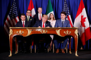 U.S. President Donald Trump, Canada's Prime Minister Justin Trudeau and Mexico's President Enrique Pena Nieto attend the USMCA signing ceremony before the G20 leaders summit in Buenos Aires, Argentina. Photo by Kevin Lamarque/Reuters