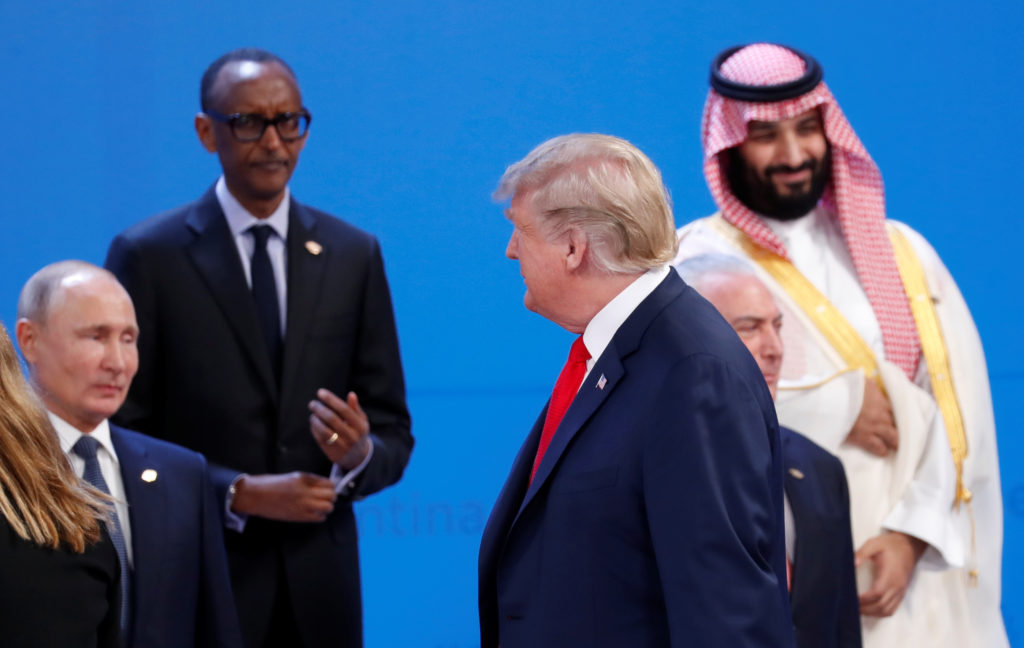 U.S. President Donald Trump walks past Russia's President Vladimir Putin, Rwandan President and African Union chairperson Paul Kagame, Saudi Crown Prince Mohammed bin Salman and Brazil's President Michel Temer as he arrives for a family photo during the G20 leaders summit in Buenos Aires, Argentina November 30, 2018. REUTERS/Kevin Lamarque