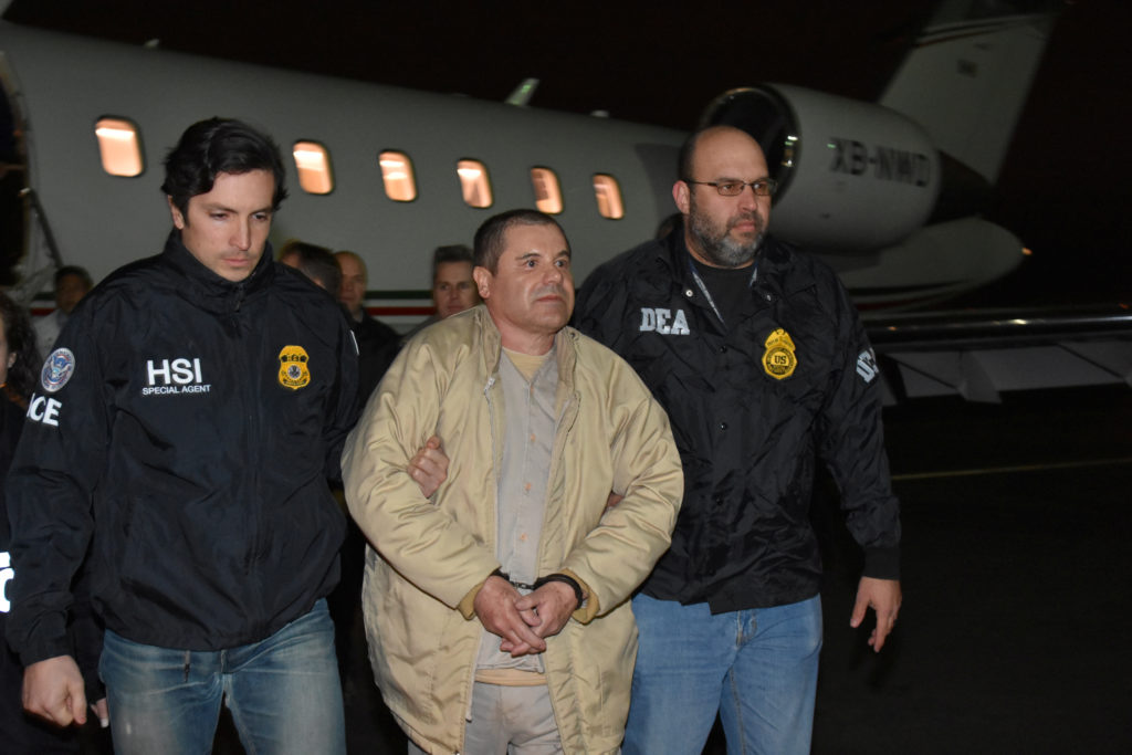 """Mexico's top drug lord Joaquin """"El Chapo"""" Guzman is escorted as he arrives at Long Island MacArthur airport in New York, Jan. 19, 2017, after his extradition from Mexico. Photo by U.S. officials via Reuters"""