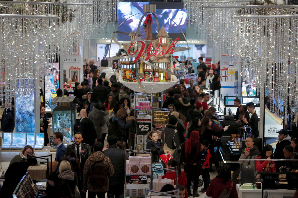 People shop in Macy's Herald Square during early opening for the Black Friday sales in Manhattan last year. Americans are expected to spend more this year because of the improved economy. Photo by Andrew Kelly/Reuters