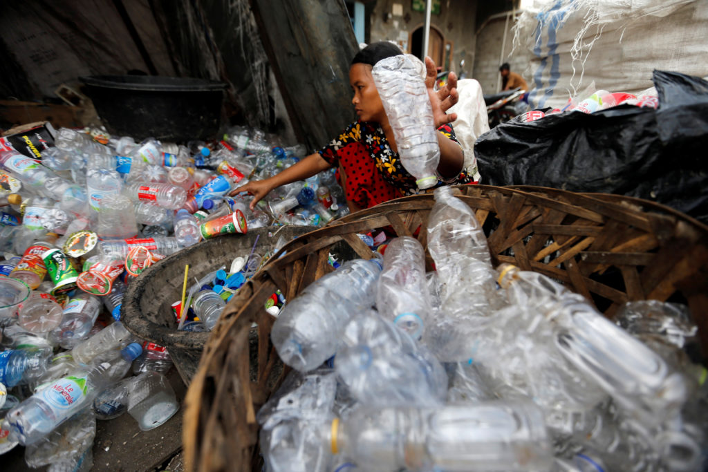 A woman sorts plastic bottles for recycling at Cilincing district in Jakarta, Indonesia. Since China stopped accepting most recyclables from other countries, Western nations have begun to ship more of their waste to Southeast Asia. Photo by Beawiharta/Reuters