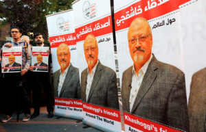 Friends of Saudi journalist Jamal Khashoggi hold posters and banners with his pictures during a demonstration outside the Saudi Arabia consulate in Istanbul, Turkey on Oct. 25. File photo by Osman Orsal/Reuters