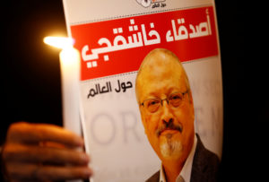 A demonstrator holds a poster with a picture of Saudi journalist Jamal Khashoggi outside the Saudi Arabia consulate in Istanbul, Turkey on Oct. 25, 2018. Photo by REUTERS/Osman Orsal