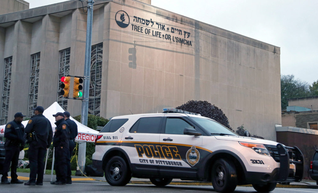 Police officers guard the Tree of Life synagogue following Saturday's shooting at the synagogue in Pittsburgh. Photo by Aaron Josefczyk/Reuters