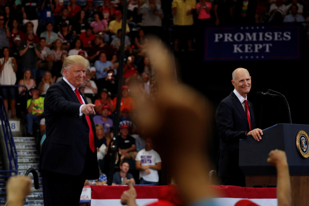 Florida Governor Rick Scott (R) speaks at a campaign rally with U.S. President Donald Trump in Estero, Florida, U.S.,  October 31, 2018.   Photo by Carlos Barria/Reuters