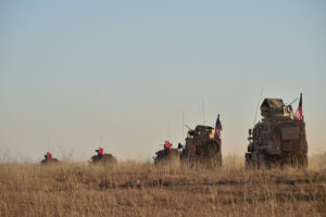 Turkish and U.S. troops are pictured during a joint patrol around Manbij, northern Syria. Picture taken Nov. 1, 2018. Photo by Turkish Defence Ministry/Turkish Military via Reuters