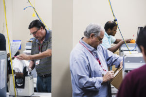 Voting technicians work in the ballot room at the Broward County Supervisor of Elections office in Lauderhill, FL on Wednesday, November 14, 2018. Photo by Scott McIntyre for PBS New Hour