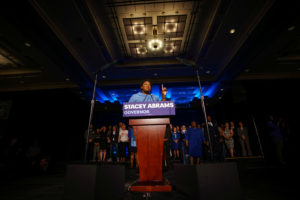 Stacey Abrams speaks to the crowd of supporters announcing they will wait till the morning for results of the mid-terms election at the Hyatt Regency in Atlanta, Georgia. Photo by Lawrence Bryant/Reuters