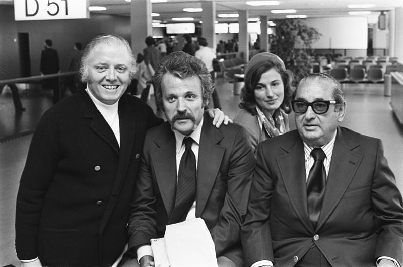 """The filmmakers of """"A bridge too far,"""" included (from left to right) director Richard Attenborough, screenwriter William Goldman and producer Joe Levine. Photo courtesy of the Dutch National Archive"""