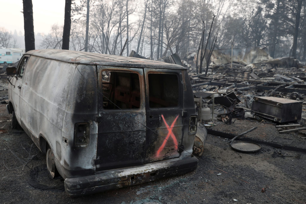 A van marked by search crews is seen in the aftermath of the Camp Fire in Paradise, California, U.S., November 17, 2018.  REUTERS/Terray Sylvester