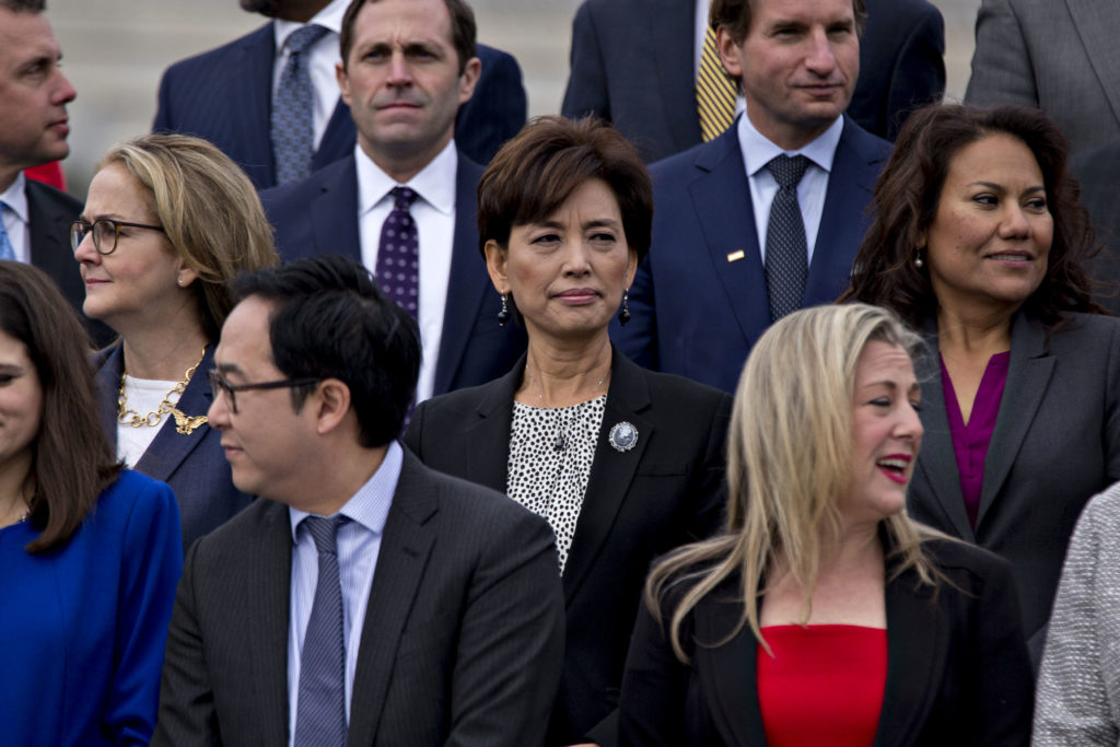 Young Kim, Republican U.S. Representative candidate from California, center, wait for a group photo with the 116th Congress outside the U.S Capitol in Washington, D.C., U.S., on Wednesday, Nov. 14, 2018. Congress returns to work this week with Democrats and Republicans promising to work together to avert a partial government shutdown and pass a handful of other bills, though President Donald Trumps demand to fund his border wall could blow up their plans. Photographer: Andrew Harrer/Bloomberg via Getty Images