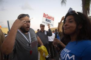 LAUDERHILL, FL - NOVEMBER 09: Protesters confront each other outside the Broward County Supervisor of Elections office on November 9, 2018 in Lauderhill, Florida. According to reports, both the gubernatorial and Senate races were separated by less than half a percentage point in which Florida law mandates a recount of machine votes. Republican Florida Gov. Rick Scott leads incumbent Sen. Bill Nelson, the Democratic opponent, by 0.2 percent margin in the Senate race. Former GOP Rep. Ron DeSantis leads Tallahassee Mayor Andrew Gillum, the Democratic opponent, by a 0.47 percent margin in the gubernatorial race. (Photo by Saul Martinez/Getty Images)