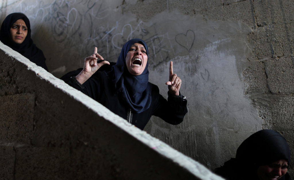 A relative of Palestinian Khaled Qwaider, who was killed in an Israeli air strike, reacts during his funeral, in Khan Younis in the southern Gaza Strip November 12, 2018. REUTERS/Suhaib Salem TPX IMAGES OF THE DAY - RC16BC098DE0